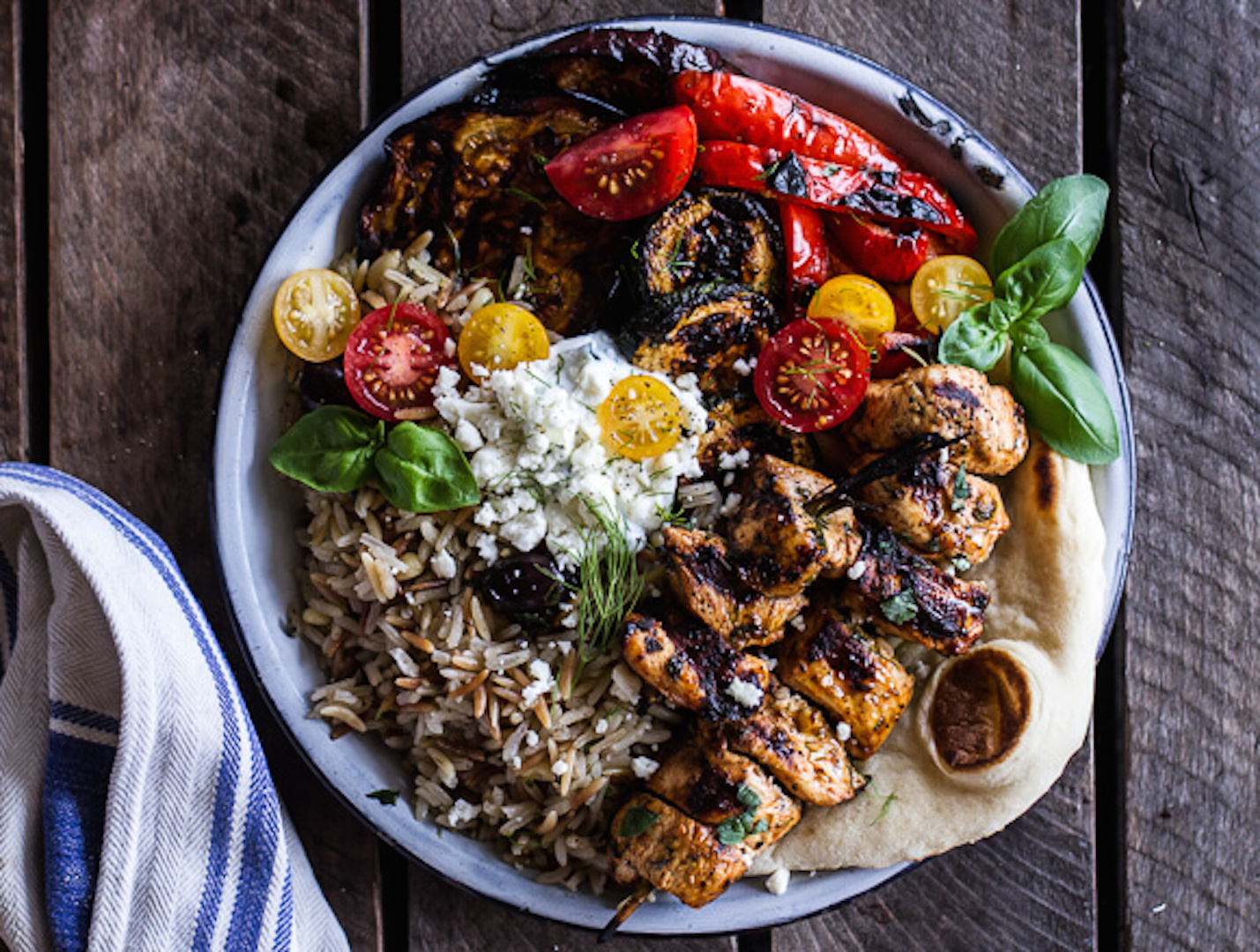 Greek Chicken Souvlaki And Rice Pilaf Plates W Marinated Veggies Feta Tzatziki A Menu For You