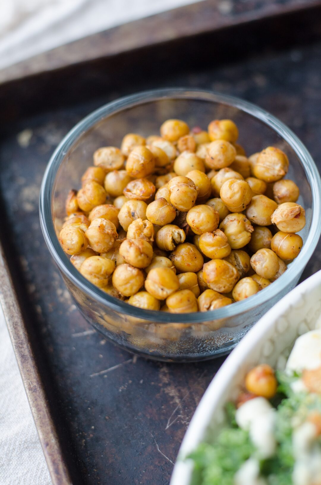 overhead photo of chickpeas in round bowl on tray