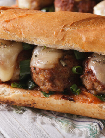 close-up side view of cheesy chicken meatball sub sandwich