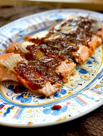 side view of salmon slices on a platter topped with a chili-mustard glaze