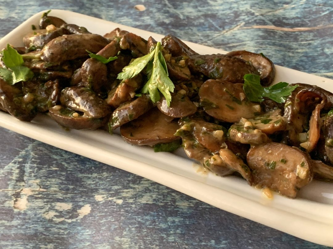 mushrooms on a tray with parsley
