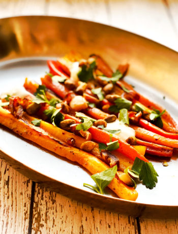 carrots on platter with fresh herbs