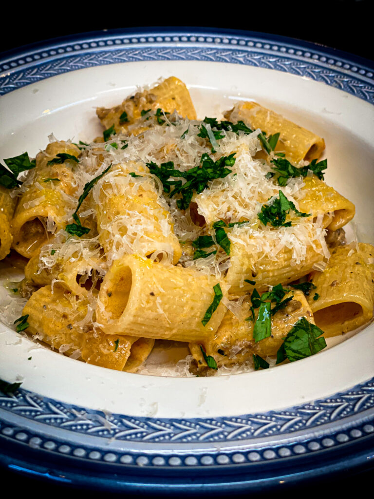 overhead shot of pasta with cheese in blue dish