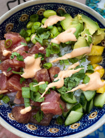 overhead of bowl with ahi tuna, avocado, cilantro and spicy mayo