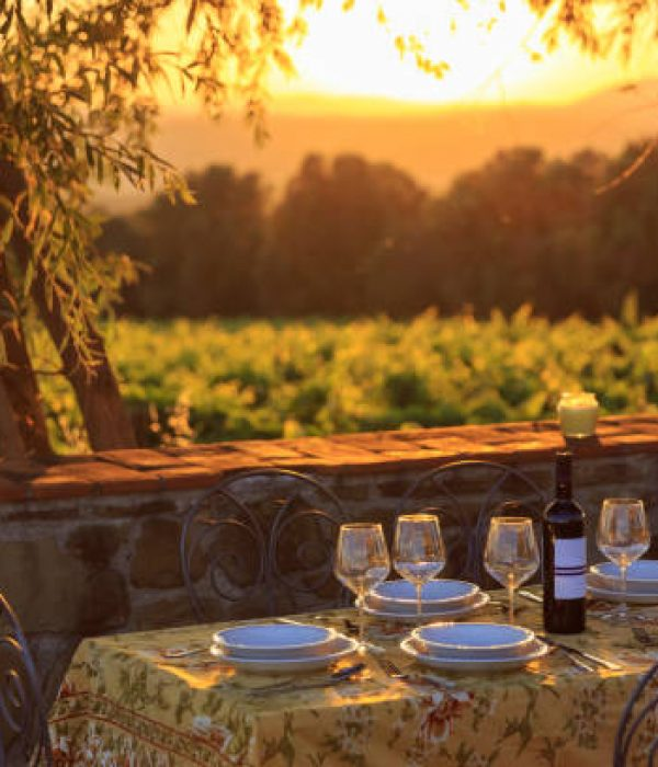Outdoor table with vineyard background in susnet time in tuscany italy